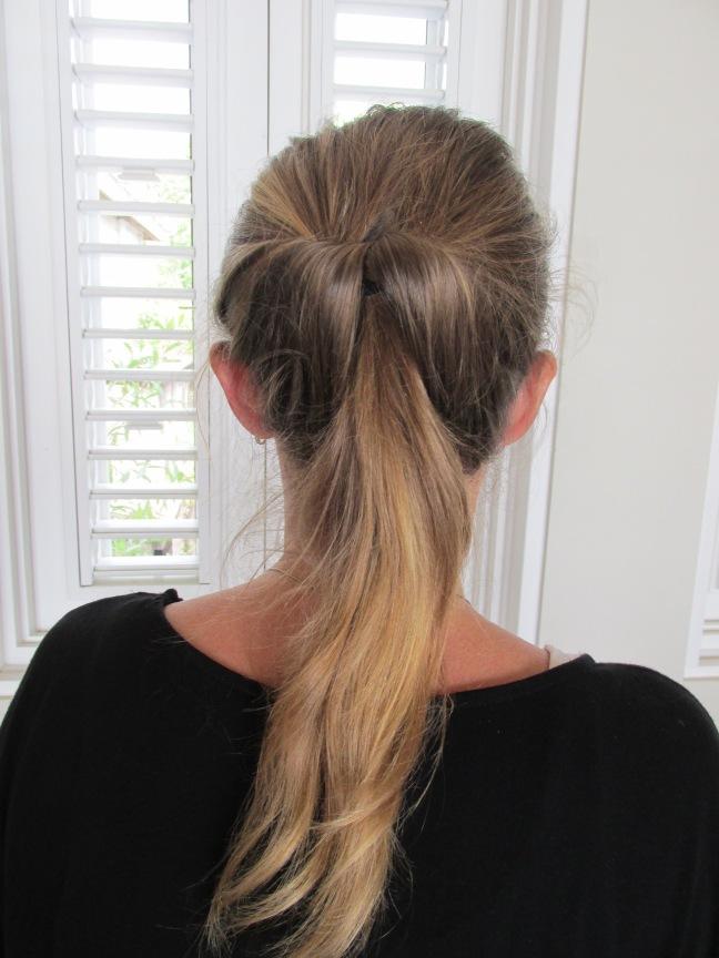 Looped through ponytail