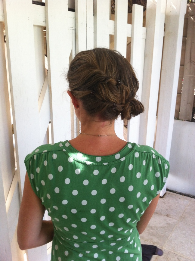 This is the side bun from behind, using small clips on rolled sections of hair