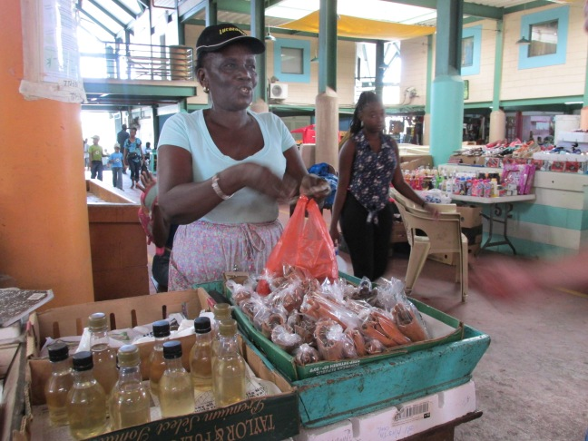 Buying spices at the market in St. John's, Antigua