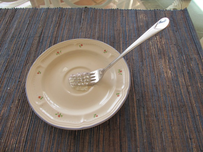 Place the fork centrally on the saucer