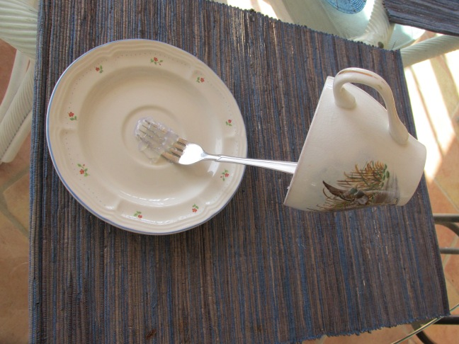 Glue the fork to the saucer and to the inside of the teacup.