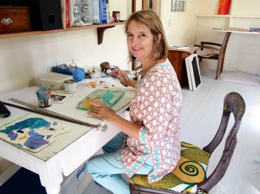 Sallie Harker painting in her studio