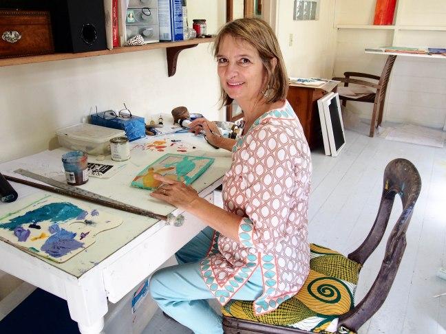 Sallie Harker painting in her studio