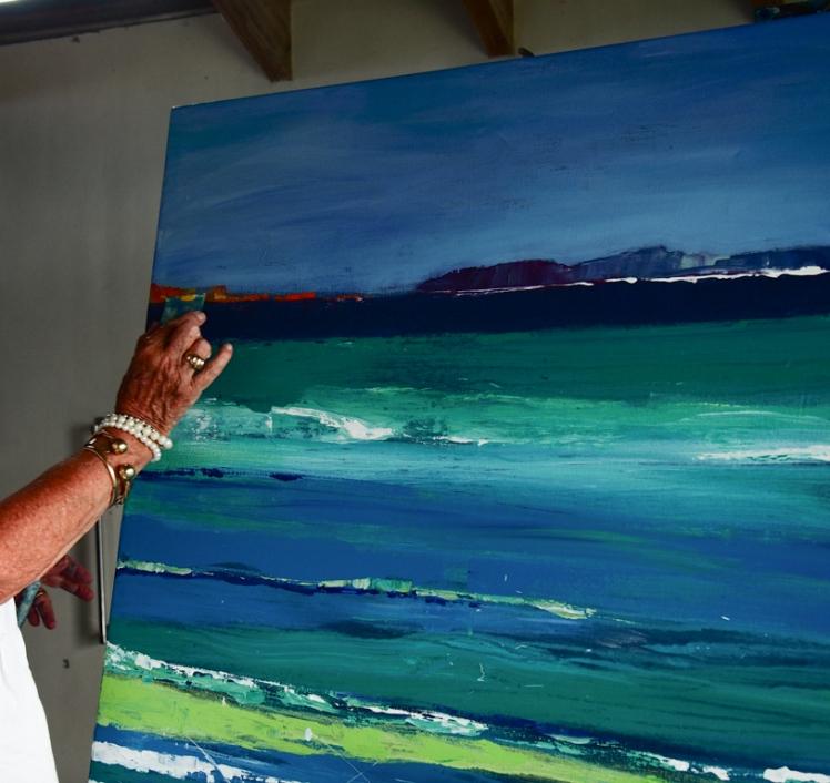 Jan Farara painting in her studio in Antigua
