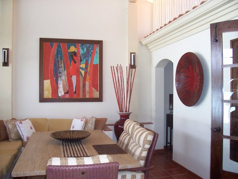 A room designed in perfect harmony with art by Jan Farara adorning the wall
